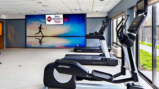 Fitness center with elliptical and treadmill visible